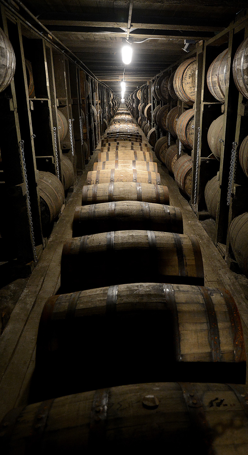 a row of bourbon barrels